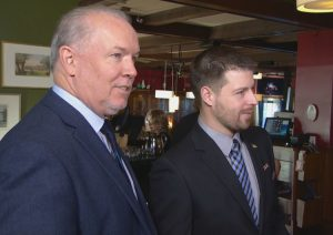 If elected in the May 9 BC provincial election, the NDP will ban grizzly bear trophy hunting. [John Horgan, left with Oak Bay-Gordon Head candidate Bryce Casavant]