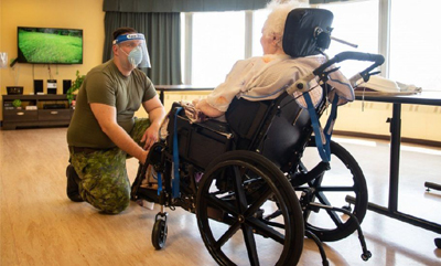 solider helping senior, long term care
