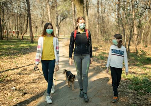 walking on trail, mask, family